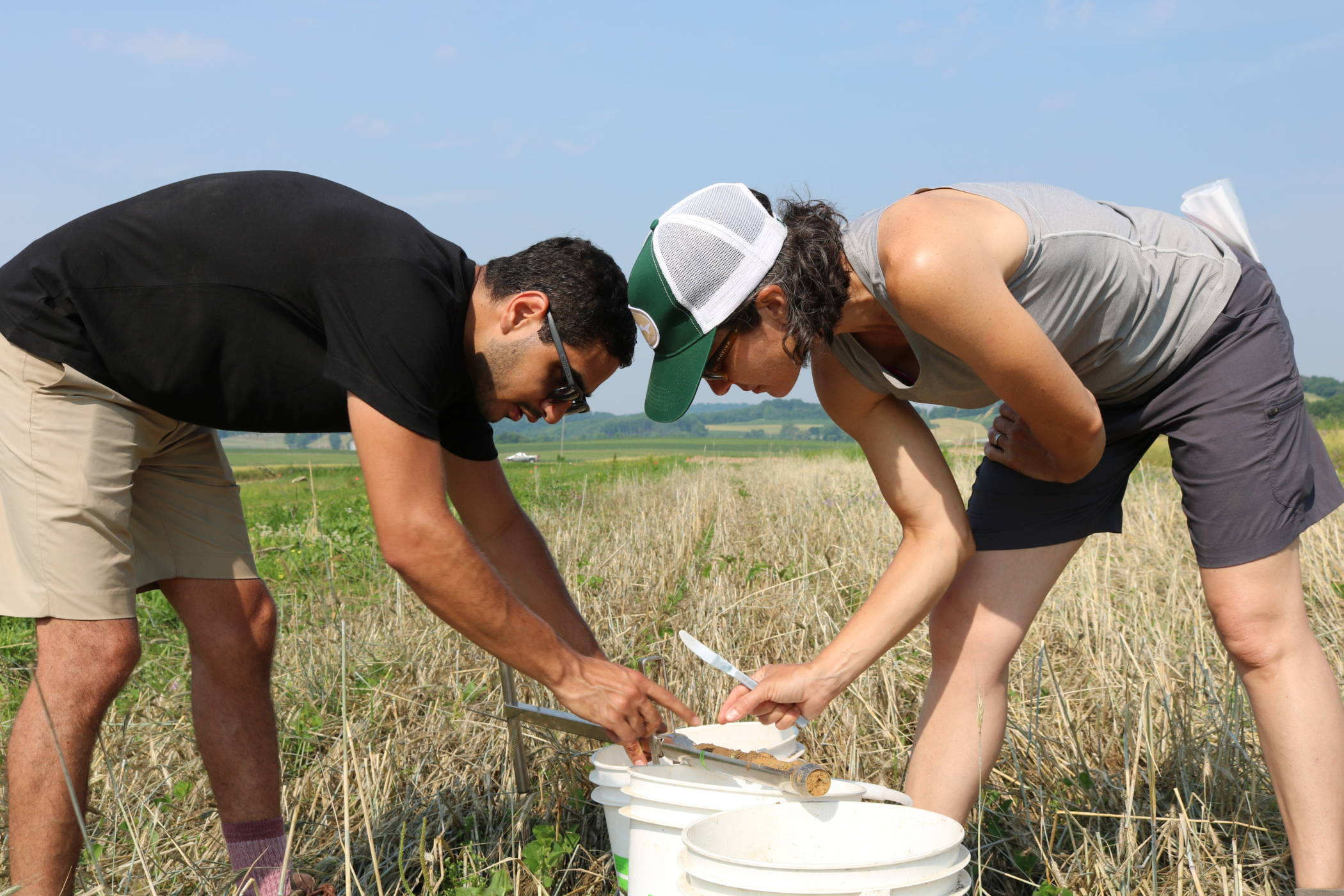 Researchers collect soil samples