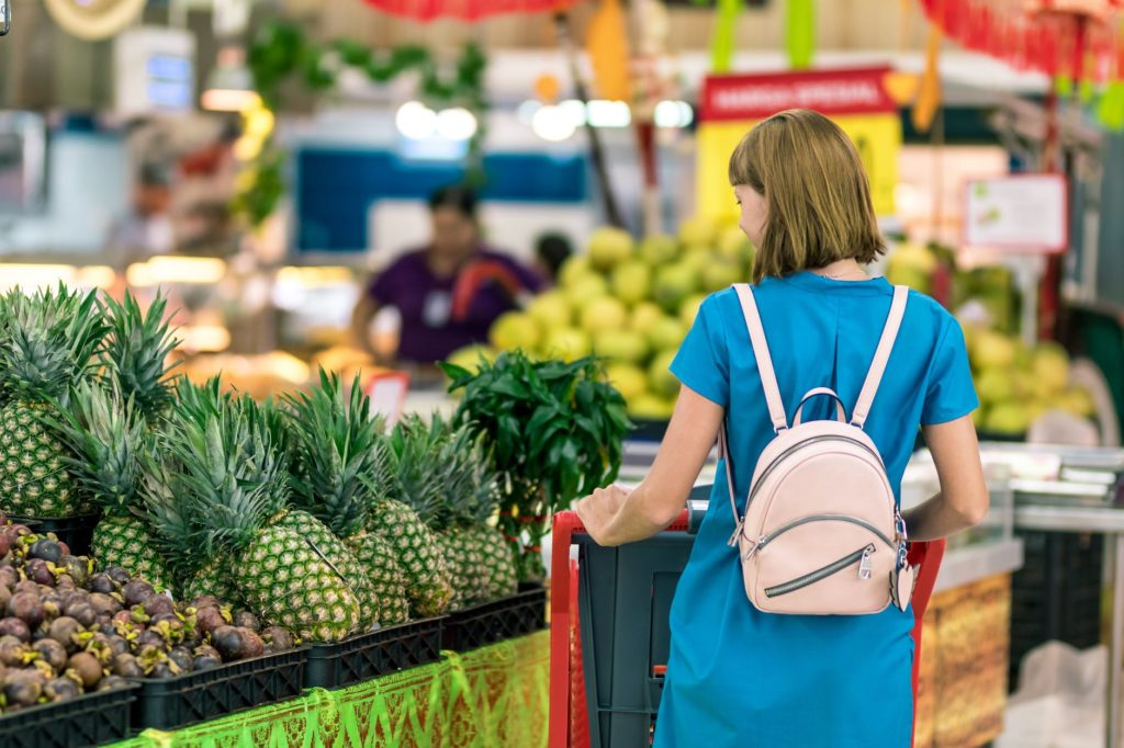 A woman shops for produce